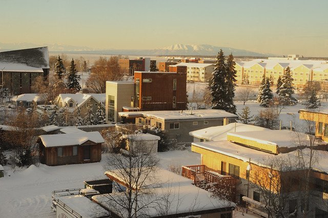 A Christmas view of Sleeping Lady, Mount Susitna across the Knik Arm of the Cook Inlet, sunny day, snow, downtown, contemporary house, church, Park Strip,  Second Addition, Anchorage, Alaska, USA