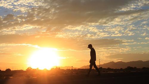 sunset monsoon whitetankmountains silhouette boy walking