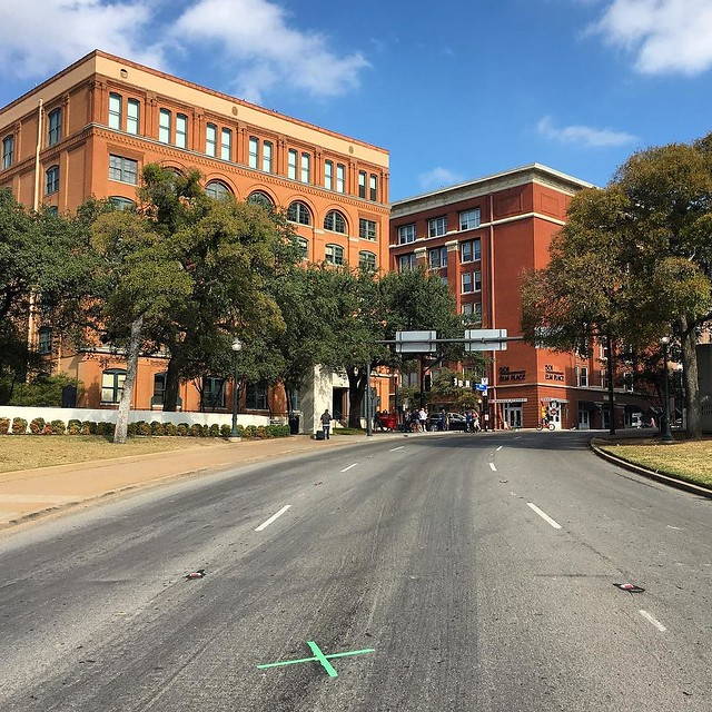Elm Street, Dallas TX. The X mark on the pavement shows the exact place JFK was shot to death on November 17th, 1963 - the gunman was allegedly positioned on the 6th floor right window of the bricks building visible in the left background. Quite an emotio
