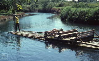 Ferry River. Man & bamboo raft. West of Kingston