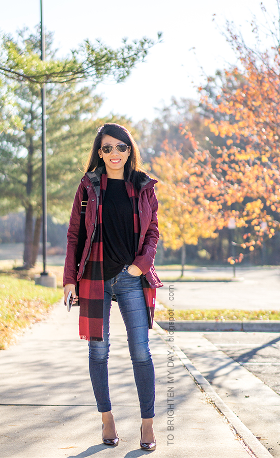 red quilted jacket, black twisted hem top, red buffalo check scarf, black shoulder bag, skinny jeans, burgundy pumps