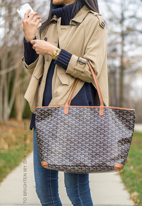 camel trench cape, navy turtleneck tunic sweater, patterned tote, skinny jeans, gold watch