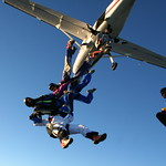 Experienced skydivers exiting the airplane.  Photo by Tony Crimando
