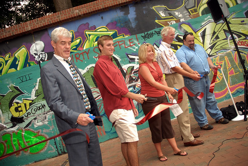 Vice-Chancellor Tom Stafford (left), Student Body President Will Quick, student Amber Nettles, project design manager Steve Bostian and project construction manager John Palmiter officially re-open the Free Expression Tunnel.