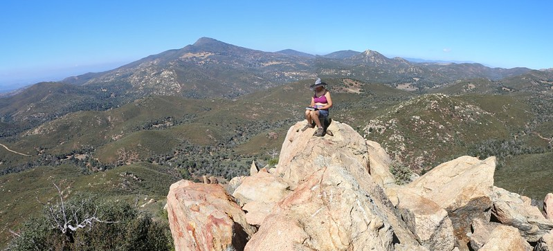 Vicki relaxing on top of Oakzanita Peak, looking north toward Cuyamaca, Middle, North, and Stonewall Peaks