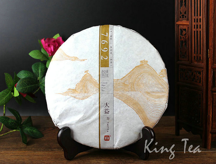 Free Shipping 2015 TAE TEA DaYi 7692 Bing Cake Beeng 357g China YunNan MengHai Chinese Puer Puerh Ripe Tea Cooked Shou Cha Premium