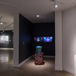 Art & Conflict Exhibition View - Photograph by Wes Magyar
