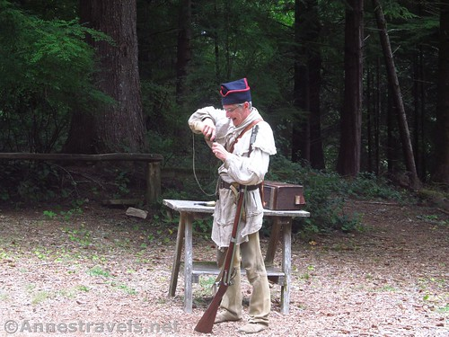 Prepping the musket with powder at Fort Clatsop, Lewis & Clark National Historical Park, Oregon