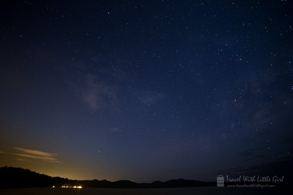 Light from the Telunas Beach Resort with stars, Telunas Private Island