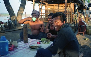 Cambodian laborers drinking rice wine.