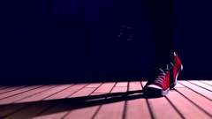 Red sneakers in shadows