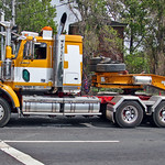 Western Star prime mover hauling Sumimoto excavator on Drake trailer