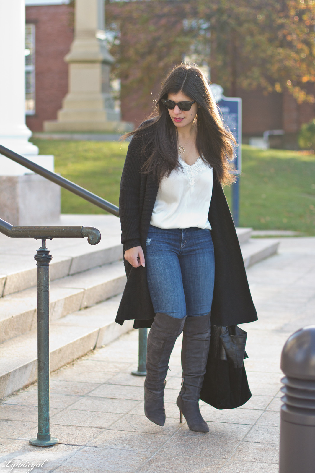 How to style over the knee boots with jeans