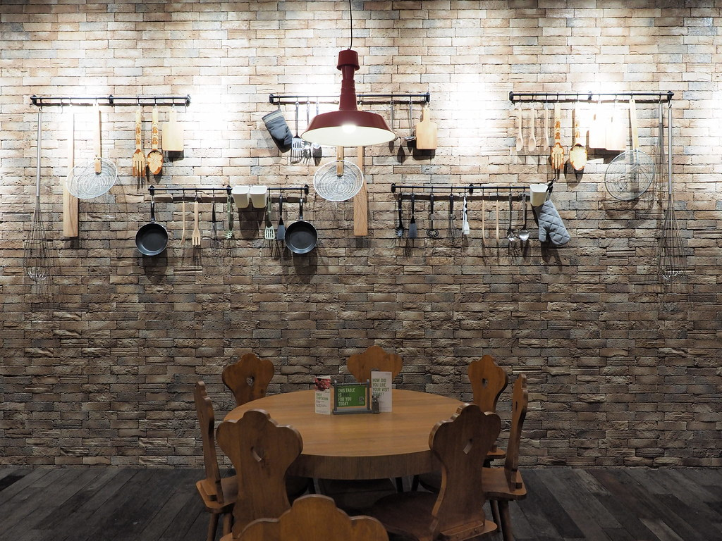 The wall with kitchen utensils at Marché Mövenpick