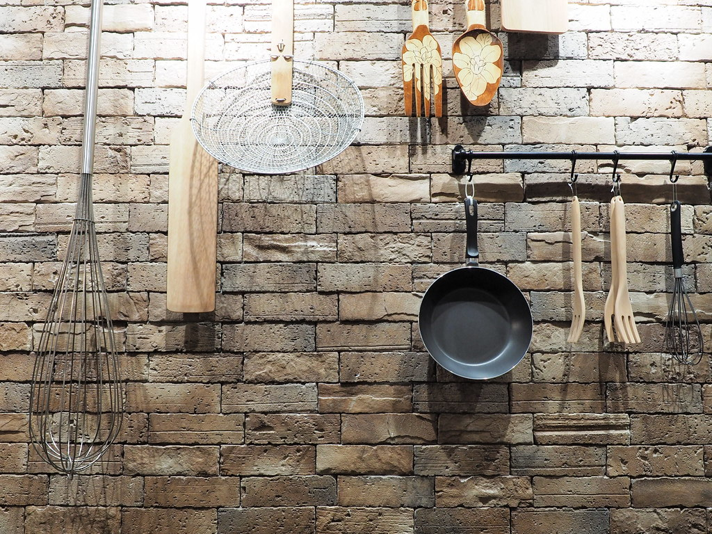 The wall with kitchen utensils at Marché Mövenpick Pavilion