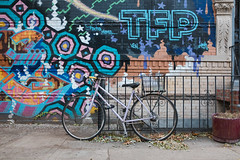 Purple Ross Bicycle in Front of Mural