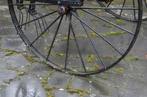 Iron wheel on a farm in Dinant, Belgium