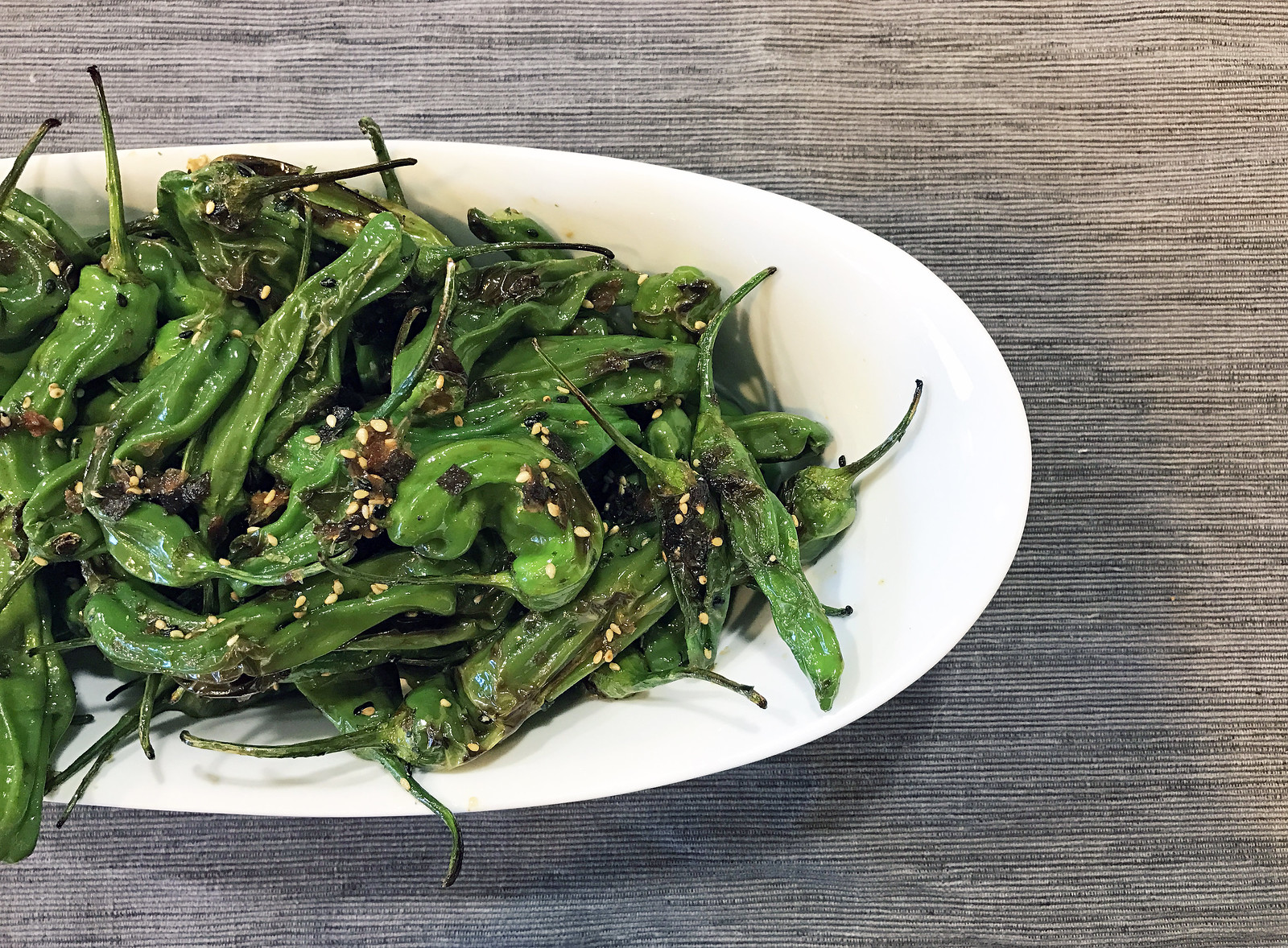 Charred shishito peppers with furikake
