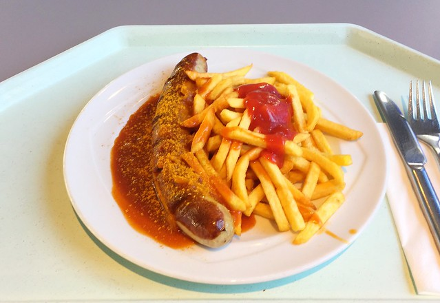 Curried fried sausage with french dries / Currywurst mit Pommes Frites