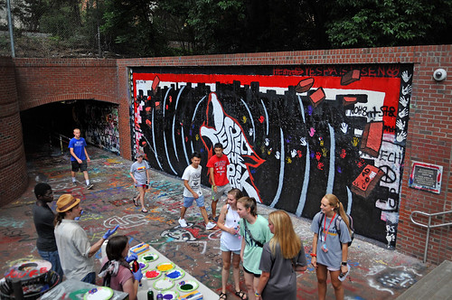 Students begin to gather at the Free Expression Tunnel to paint the wall for the 2017 Respect The Pack.
