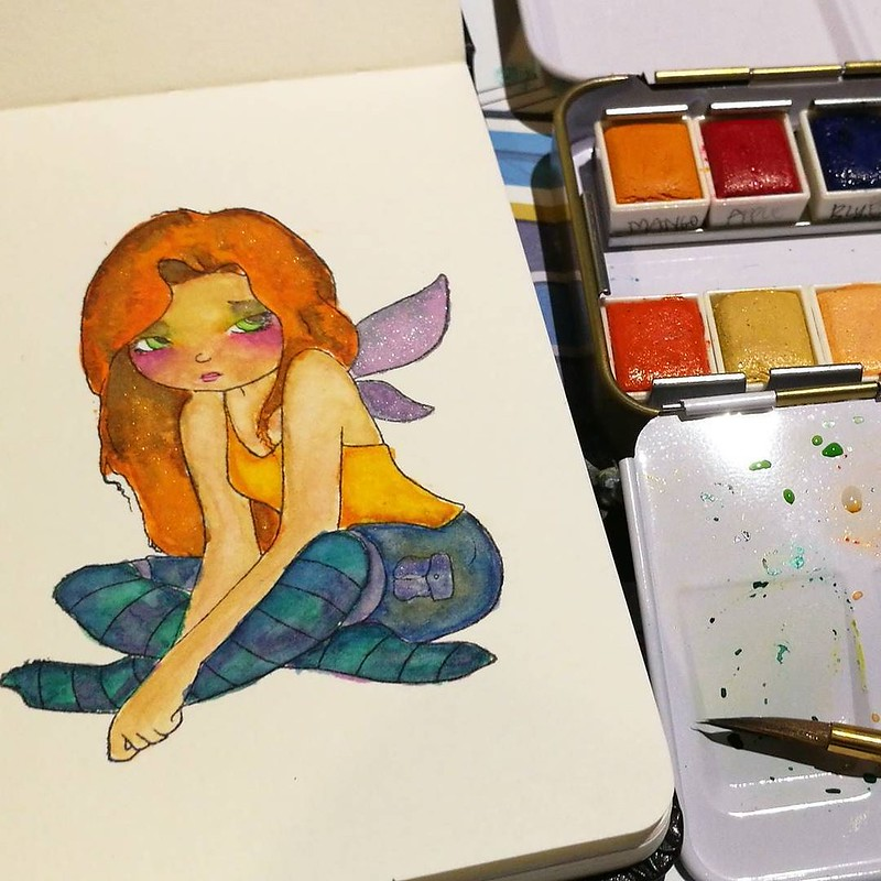 Work in progress, autumnal fairy girl with #janedavenport #watercolorpaint in a @moleskine_world watercolor pocket book.
