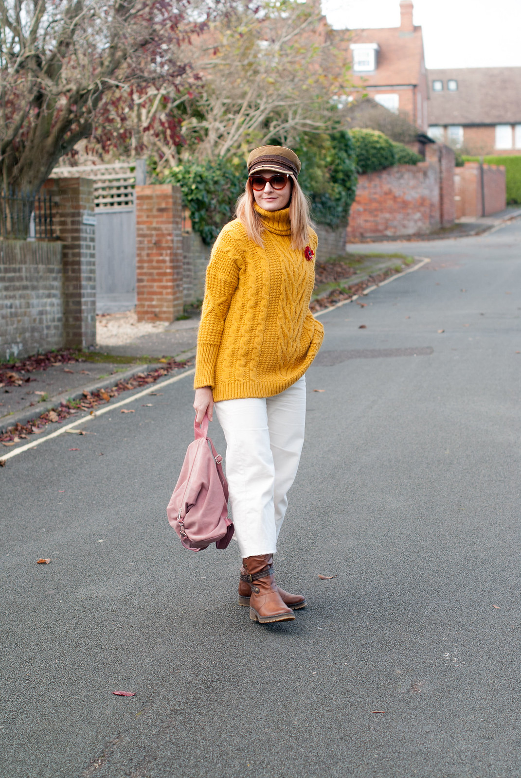 Autumn winter fall style - casual fall dressing - Mustard M&S cable knit oversized roll neck sweater \ white cropped wide leg jeans \ tan boots \ camel baker boy hat \ pink suede backpack | Not Dressed As Lamb, over 40 style