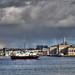 Naval tug passses Royal William Yard, Plymouth