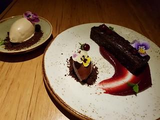 Warm chocolate brownie, salted caramel ice cream, hazelnut ganache, cherry gel at Transformer