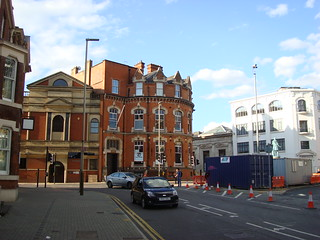 A curved brick building and its neighbours in or near Welford Place, Leicester