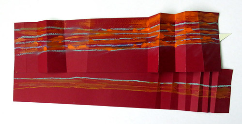 Front of a folded piece of 2-ply paper that was burgundy on one side and cream on the other; this side was painted with acrylic stripes