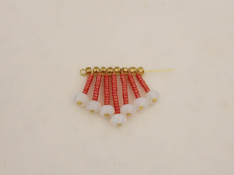 add beads and pins in a pattern