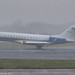T7-CAM - 2015 build Bombardier BD700 Global Express 6000, arriving on Runway 05L at Manchester during a snow flurry