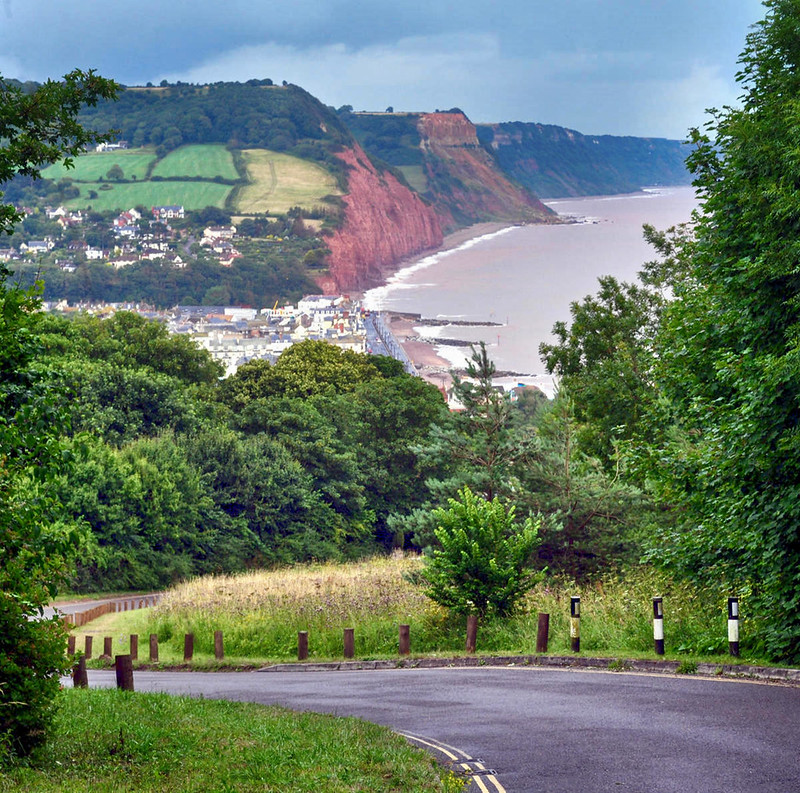 Peak Hill Road & Scenery. From the road looking back down towards Sidmouth and the Jurrasic Coast. Credit Lewis Clarke
