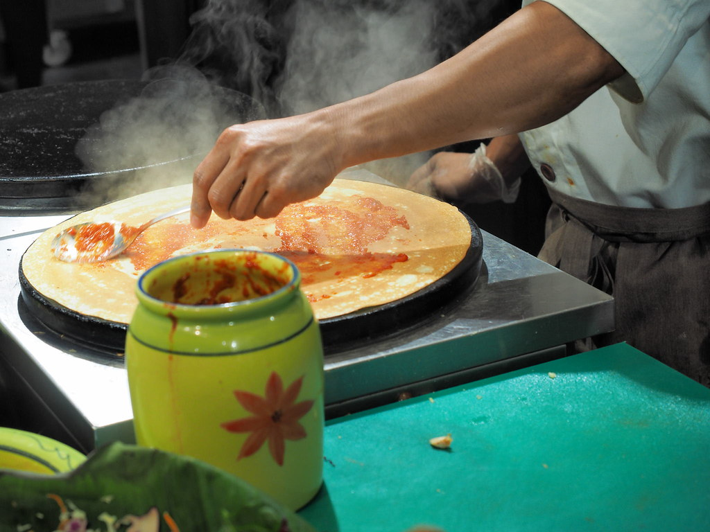 Chef preparing savoury crepe