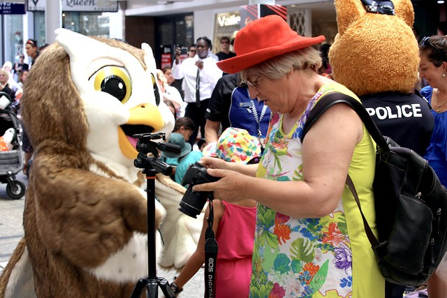 checking the photo, Queen Street Mall