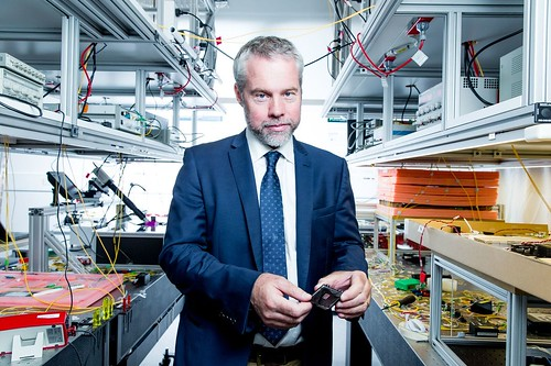 Professor Benjamin Eggleton holding a photonic chip inside the Sydney Nanoscience Hub laboratory - Image Credit CUDOS