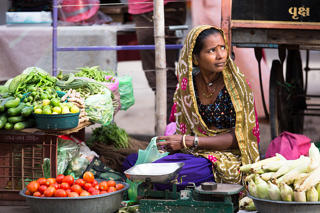 A market woman selling vegetables in Bhuj, India.