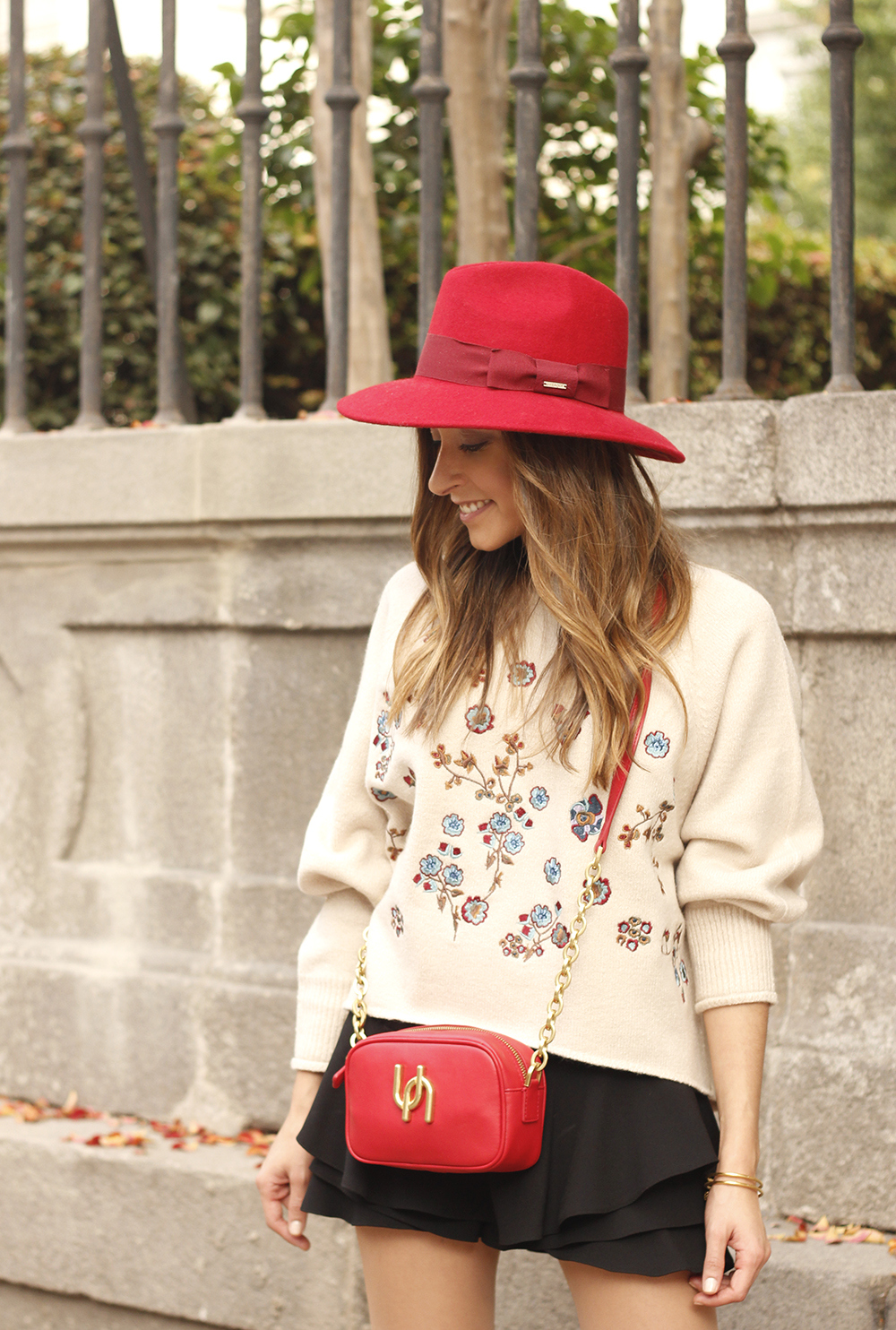 beige jersey with embroidered flowers over the knee black boots red hat street style fashion inspiration outfit12