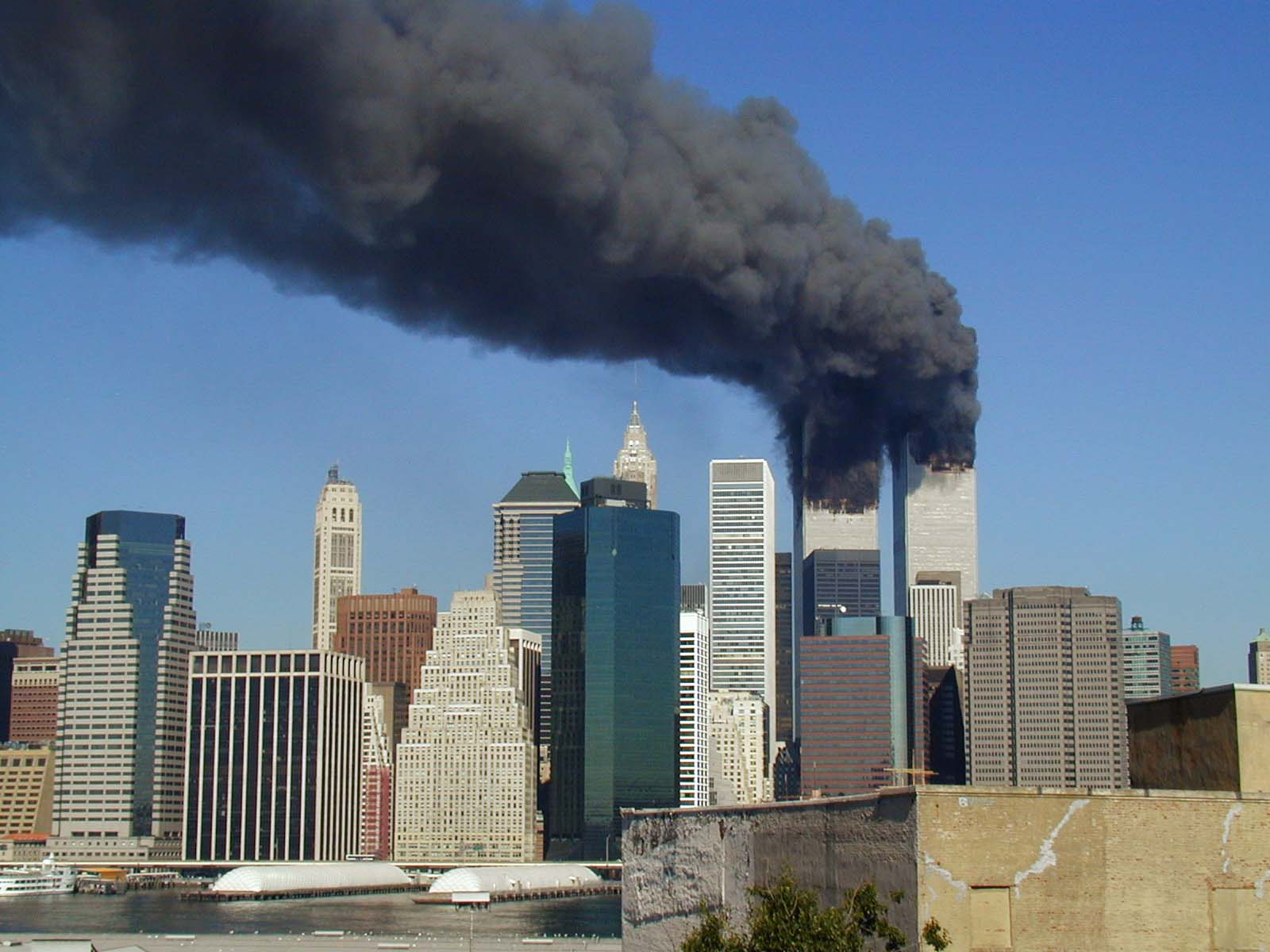 Plumes of smoke billow from the World Trade Center towers in Lower Manhattan, New York City, after a Boeing 767 hits each tower during the September 11 attacks. Photograph taken by Michael Foran.