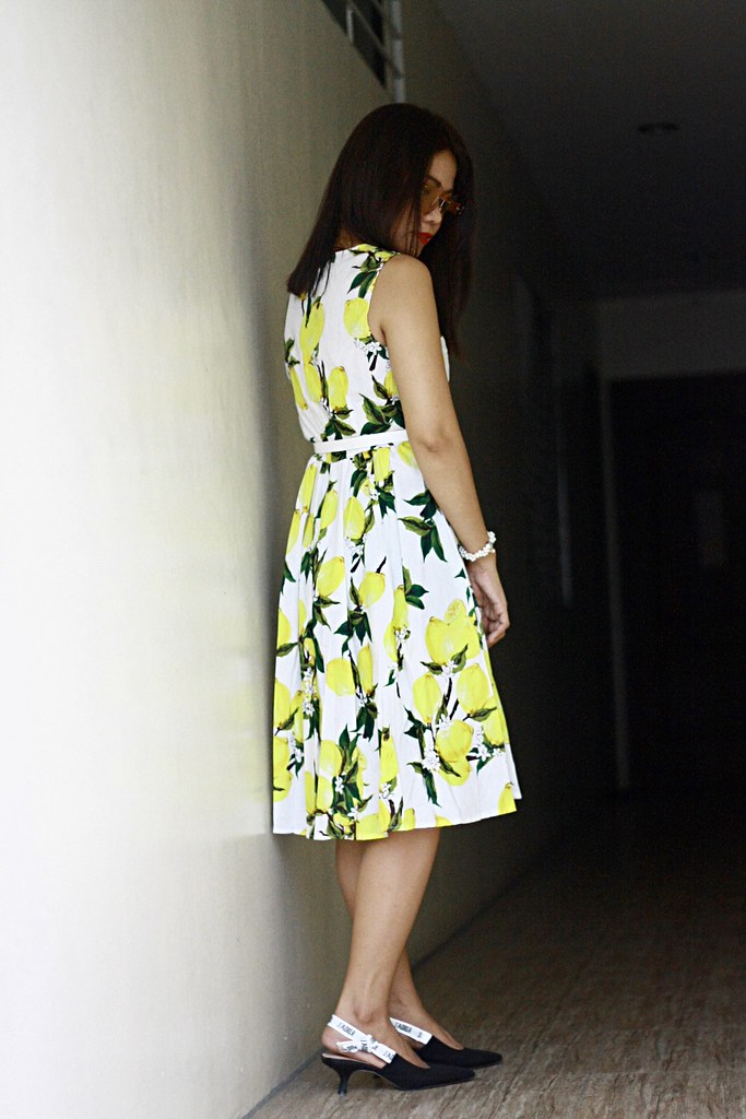 65370967b31 This sleeveless lemon print dress comes in three colors. It s too cute and  lovely