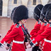 The Queens guard with bearskin marchin into Windsor Castle - England