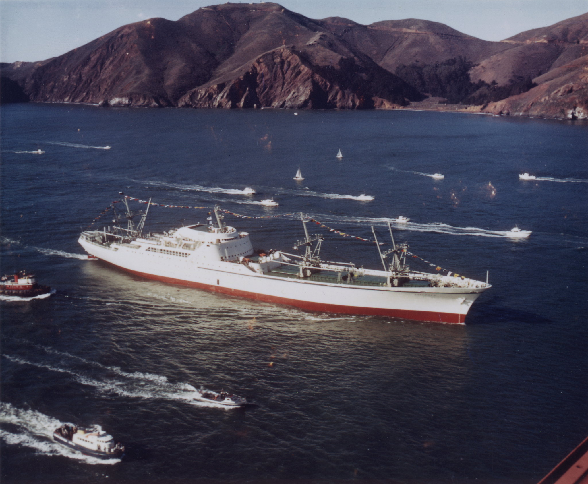 NS (Nuclear Ship) Savannah, the first commercial nuclear power cargo vessel, passing under San Francisco's Golden Gate Bridge enroute to the 1962 World's Fair in Seattle.