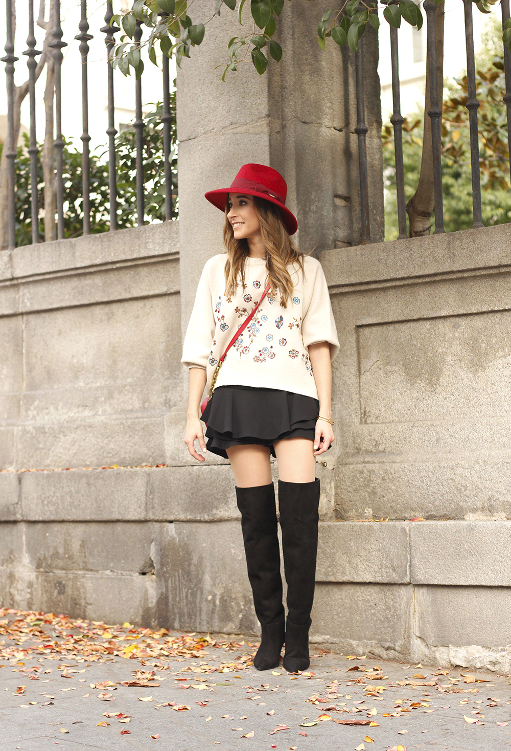 beige jersey with embroidered flowers over the knee black boots red hat street style fashion inspiration outfit01