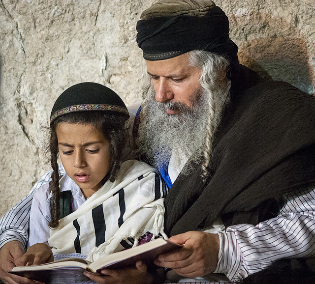 Jewish boy learning to pray at Western Wall