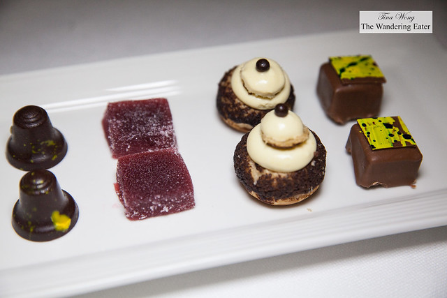 Petit fours - Dark chocolate and liquid lemon center, red pepper raspberry pate de fruit, tiramisu, and milk chocolate crispy rice and hazelnut