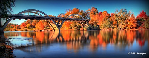 cavemanbridge grantspass fallcolors fall autumn outdoor landscape waterscape water canon eos 7d slr rogue river bridge blue sky orange red trees reflect longexposure panorama yellow architecture rogueriver