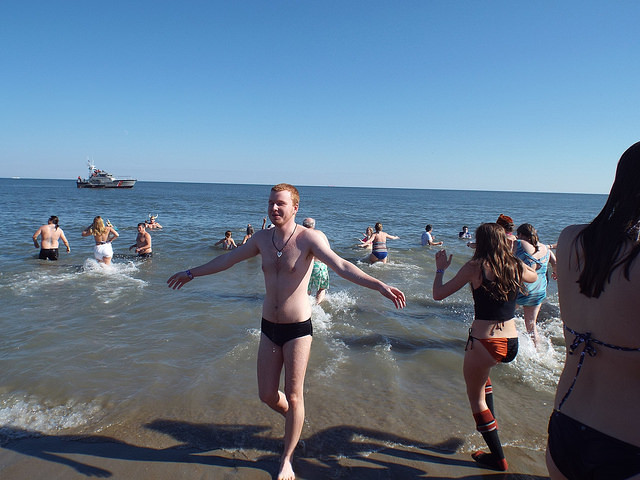 Pi Gamma Mu members, students, alumni and faculty annually plunge into the icy Atlantic water as others cheer them on and hold warm towels on the beach.