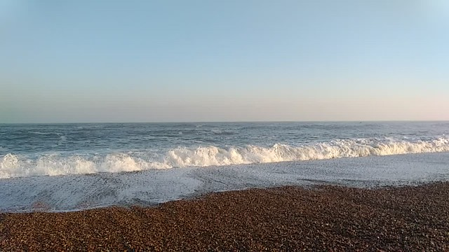 Slow motion waves crashing on Cley Beach