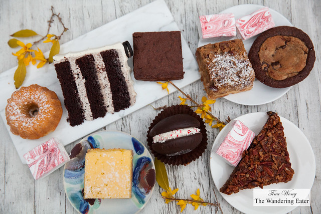 Spread of sweets from Baked - Citrus bundt cake, Cookies & Cream cake, Peppermint brownie, Apple Pie bar, Brookster, Key Lime bar, Peppermint whoopie pie, Pecan chocolate bar