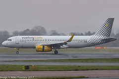 EC-MFK - 2015 build Airbus A320-232, arriving on Runway 05L at Manchester during a snow flurry